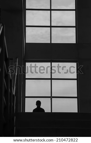 a man looking forward in front of the window - stock photo