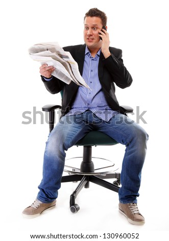 A man looks surprised, shocked while reading a newspaper speek phone white background - stock photo
