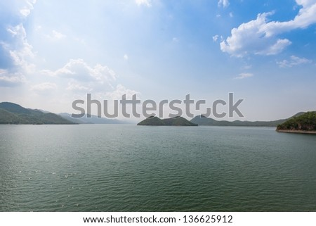 A man made lake as a result of a dam setting up in Thailand, taken on a cloudy day