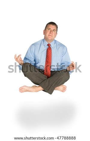 A man meditates and floats effortlessly while pondering life. - stock photo