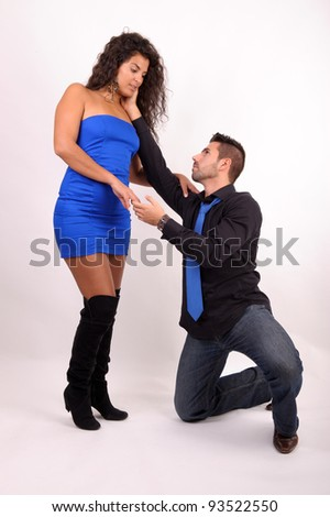a man on his knees doing a love declaration to a woman - stock photo