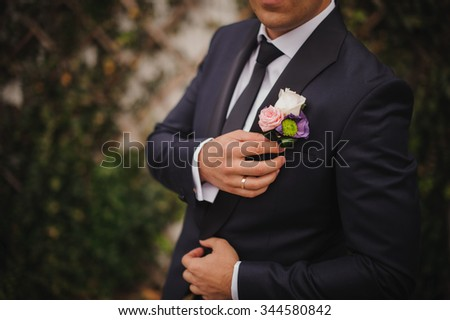 a man on his wedding day in a suit  - stock photo