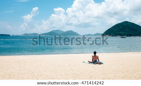 A Man on the beach at Hong Kong. Cool Tone, Lying on the beach.