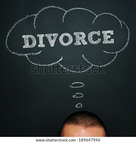 a man over chalkboard with a thought bubble drawn in it and the word divorce - stock photo
