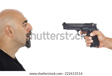 A man portrait and a gun - stock photo