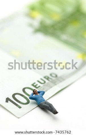 a man (puppet) sleeping on a Euro paper currency - stock photo