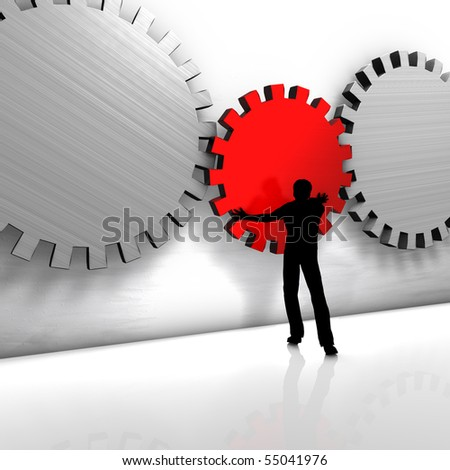 A man puts a gear. He improves a process or repairs a tool. - stock photo
