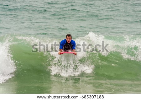 stock-photo-a-man-rides-a-wave-at-the-be
