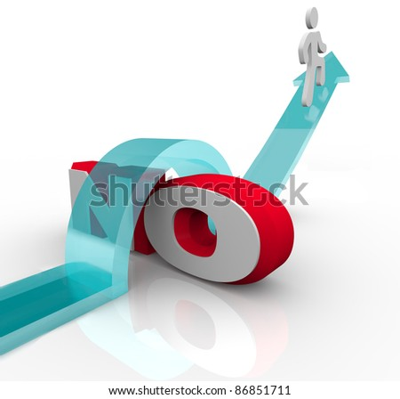 A man rides an arrow over the word No to overcome objection and beat a challenge on the way to success - stock photo
