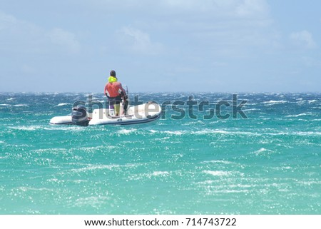 a man riding on a water scooter