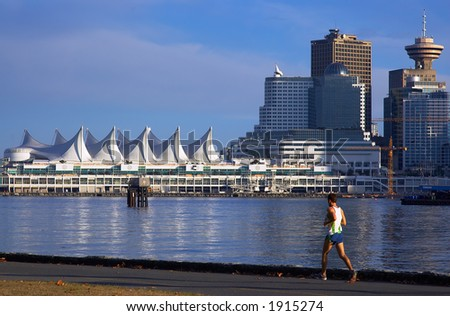 A man running along Canada Place. More with keyword group14f