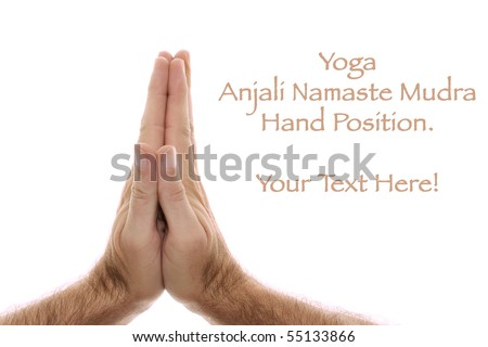A man's hand is shown in yoga Anjali mudra and is  used as a salutation or greeting hands are held over head or heart.  Shot over white. - stock photo
