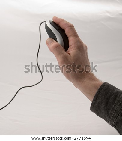 A man's hand using a mouse - stock photo
