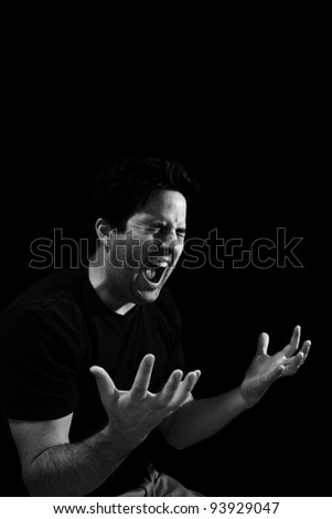 A man screams out in anguish - stock photo