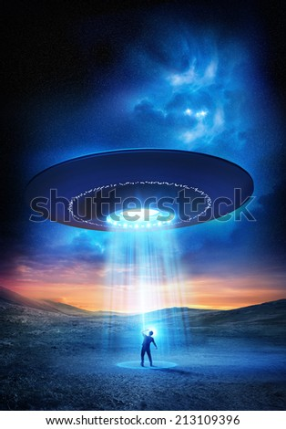 A man shields his eyes from the bright UFO above him.