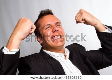 A man showing joy with his fists and arms
