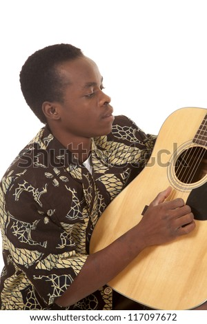 A man sitting and playing the guitar with his fingers.