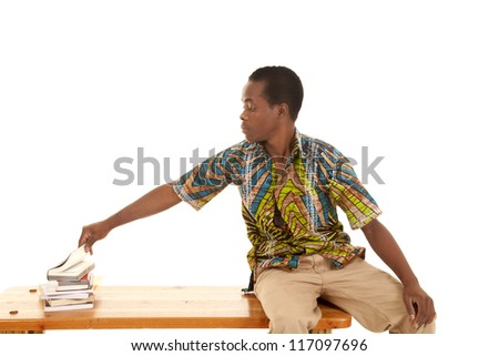 A man sitting on a bench taking a peek into a book. - stock photo