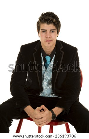 a man sitting on a chair in his business suit. - stock photo