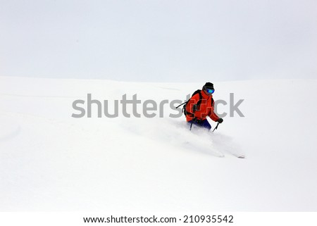 A man skiing with a white snow background, USA. - stock photo
