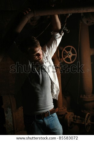 A man standing in a dark room - stock photo