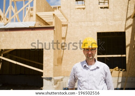 A man standing in front of a construction site.