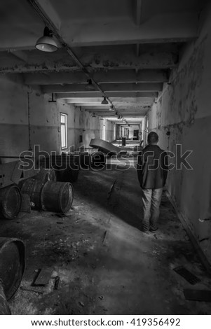 A man standing inside the Duga Radar station control room. Chernobyl Exclusion zone.  - stock photo