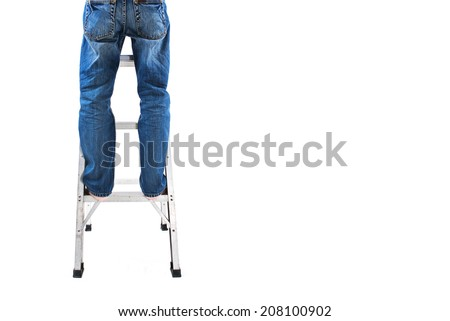 A man standing on ladder - do it yourself concept - stock photo