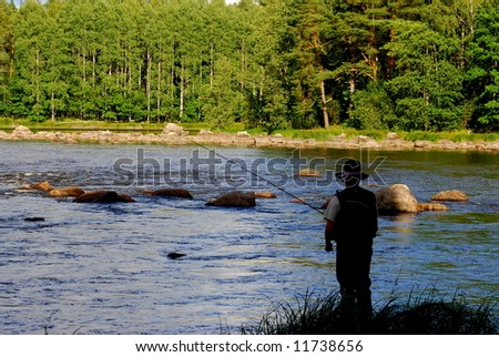 A man standing on the river bank