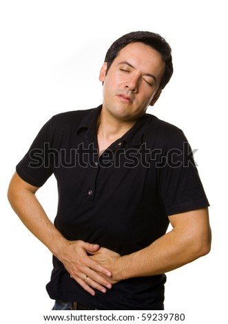 A man suffering from stomach pain, isolated on white - stock photo