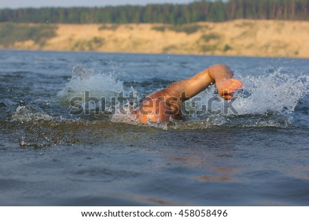 A man swimming in the sea. - stock photo