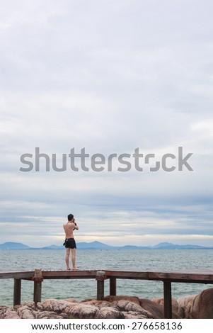 A man take photo as sea view - stock photo