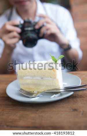 A man take the photo in cake shop