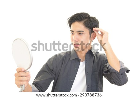 A man taking care of his hair