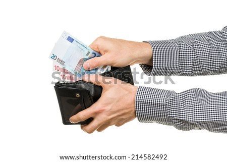 a man taking out euro banknotes out of a wallet.