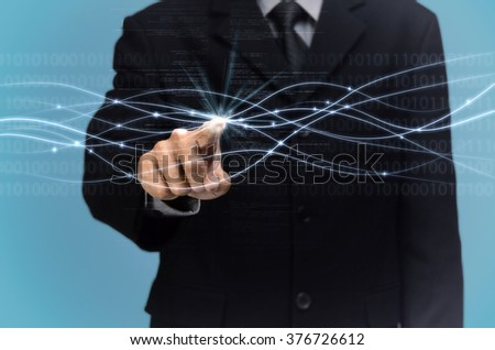 A man touching micro fiber connection. Internet conceptual image.