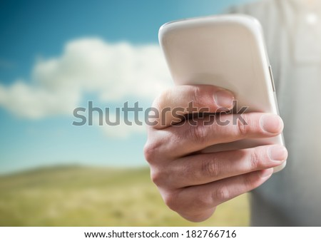 A man using a mobile phone (smartphone) - stock photo