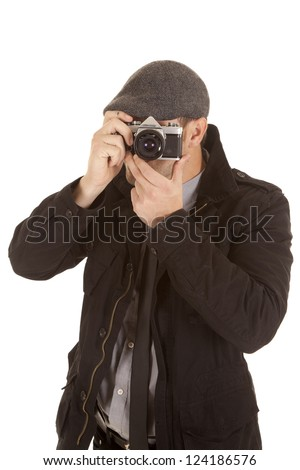 A man using a old fashioned camera to take a picture.