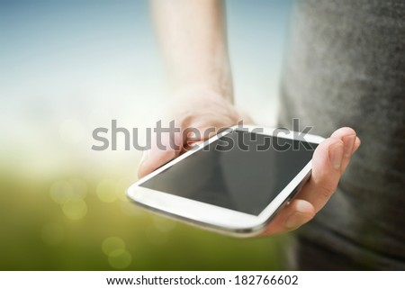A man using a smartphone (close up) - stock photo