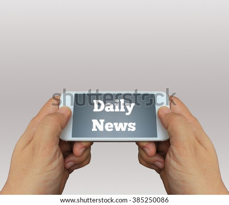 a man using hand holding the smartphone with text Daily News on display - stock photo