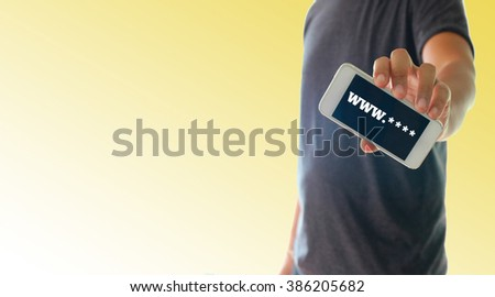 a man using hand holding the smartphone with text www on display