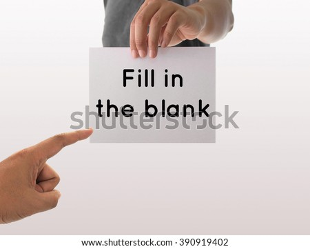 a man using hand holding the white paper with text fill in the blank - stock photo