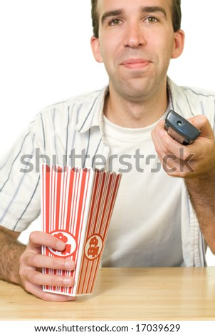A man using the remote control to change channels - stock photo