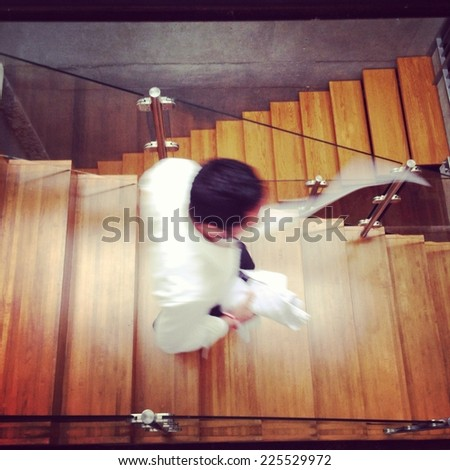A man walking down a flight of stairs. - stock photo