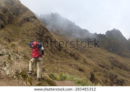 A Man walking on The Inca Trail, Machu Picchu, Peru - stock photo