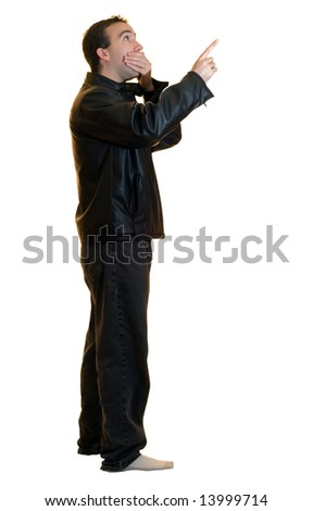 A man wearing a black leather jacket pointing at something, looking stunned - stock photo