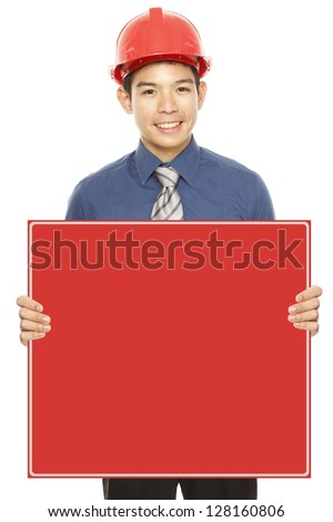 A man wearing a hardhat holding a red blank message - stock photo