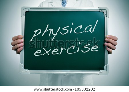 a man wearing a white coat showing a chalkboard with the text physical exercise written in it as healthy habit advice - stock photo