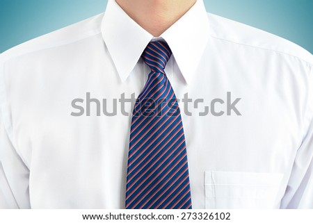 A man wearing white shirt and striped tie - soft focus - stock photo