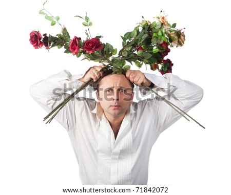 A man with a bouquet of roses on a white background - stock photo